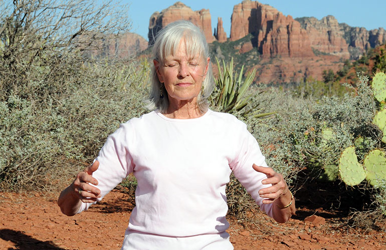Old woman practicing brain energy meditation