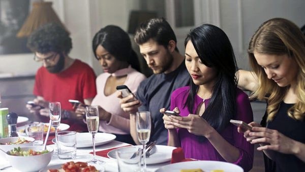 Group of friends on smartphones